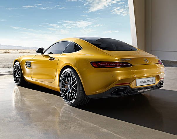 Rear View Of Yellow AMG GT Looking Out To Barren Landscape.