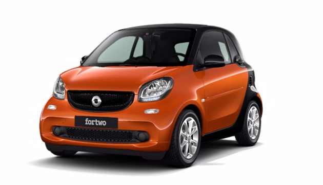 Side view of orange front-facing smart fortwo coupé on plain white backdrop